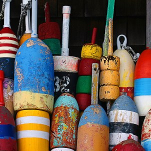 a bunch of colorful new england lobster buoys
