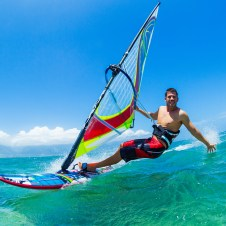 young man windsurfing