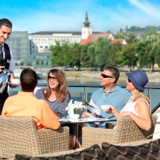 Alfresco dining with friends cruising on Europe's waterways