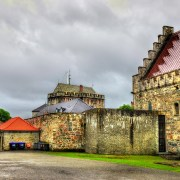 Shore excursions on Norwegian fjords cruises Bergenhus Fortress, one of the oldest and best preserved castles in Norway