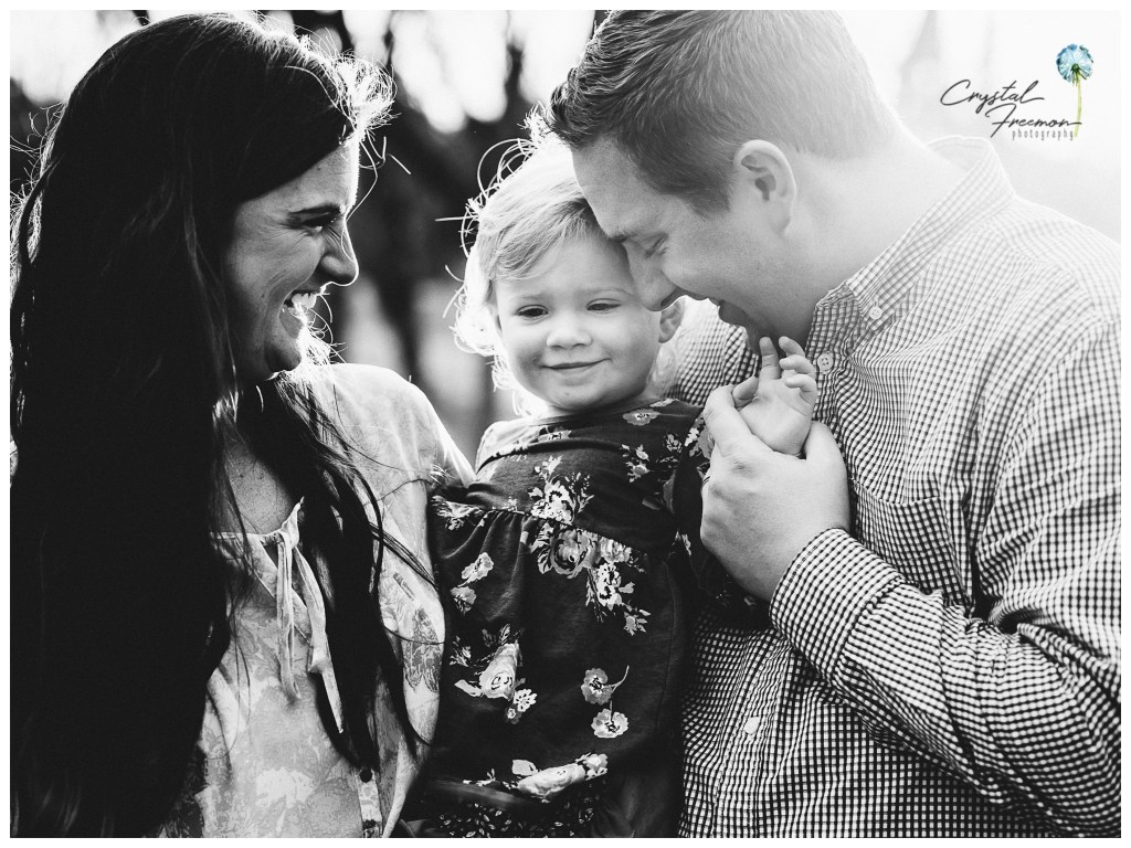 Spring Hill, TN Family Photographer Portrait of Mom and Dad with young toddler daughter.