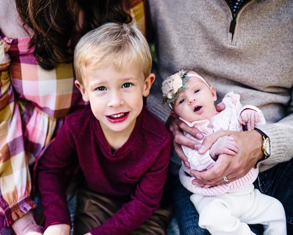 Outdoor newborn portrait with big brother