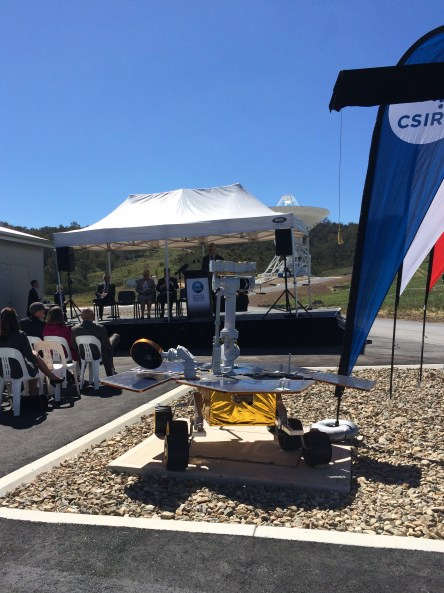 A special guest in attendance listens quietly during the ceremony - a model Mars rover!