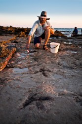 Dr Salisbury scrubbing up some Megalosauropus prints in preparation for documentation. Photo: Damian Kelly
