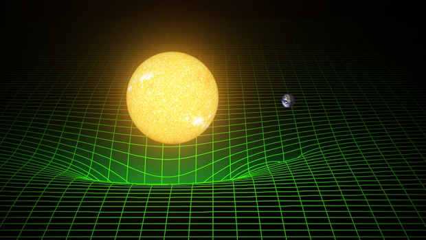 Space time (represented here with a greeen grid) is warped by massive bodies, such as the Sun and Earth. Einstein's theory predicted existence of gravitational waves, which are ripples in space and time. These waves, which move at the speed of light, are created when massive bodies accelerate through space and time. Image credit - LIGO