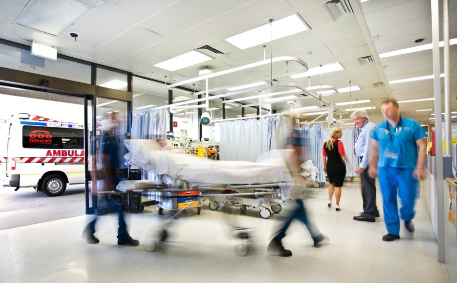 A buy hospital emergency department with a patient being wheeled in on a stretcher