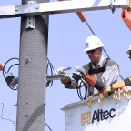 Electric lineman work to keep our power flowing
