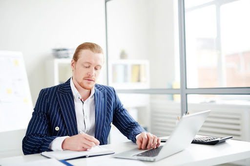 guy sitting in front of computer doing work