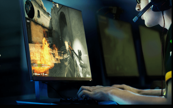 Young man playing a combat video game