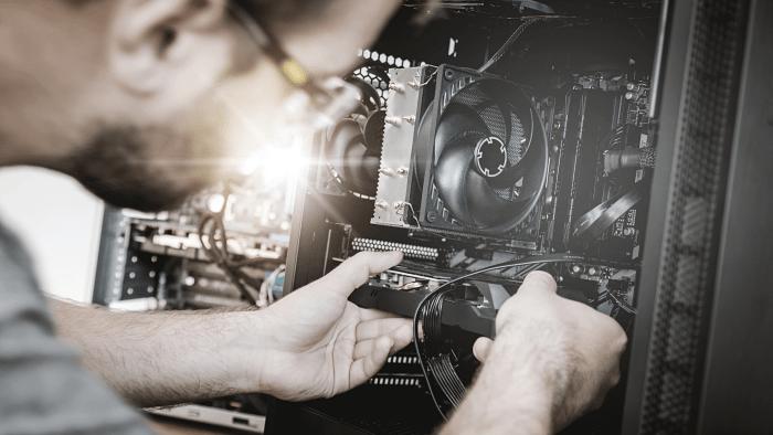 A Man placing a GPU in a PC