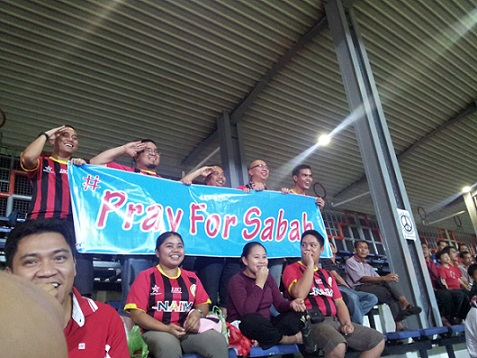 Among the few banners at the Sarawak State Stadium