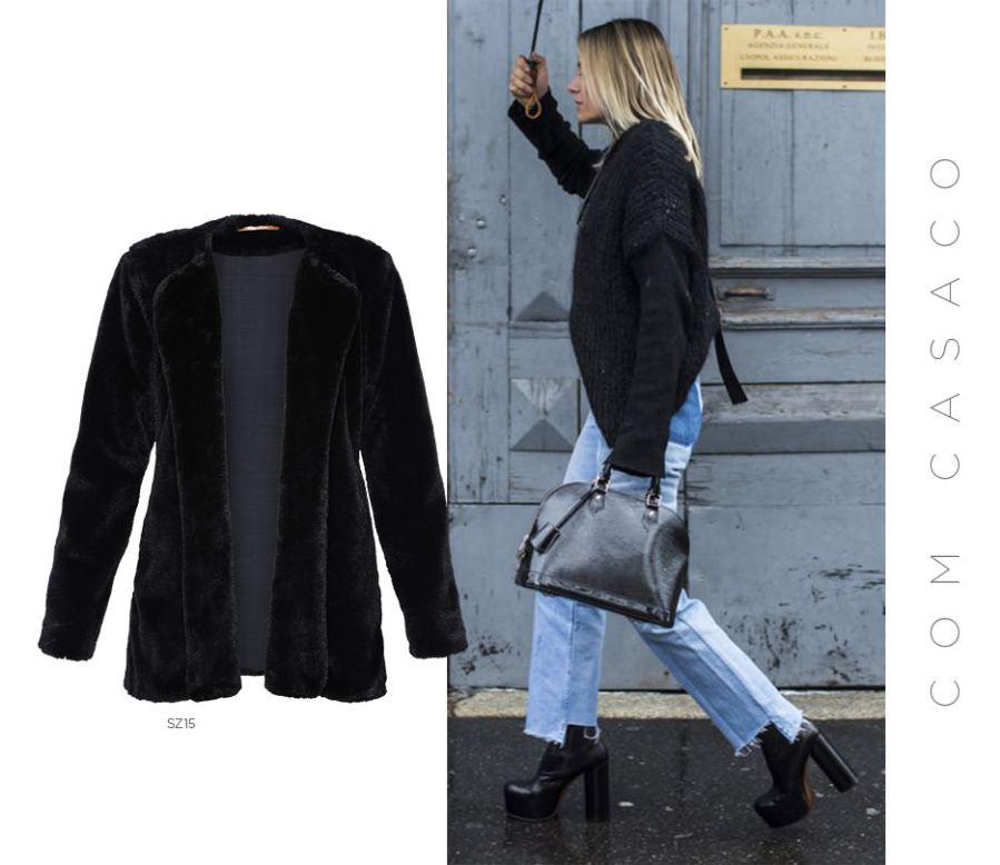 Casaco preto e jeans com barra assimétrica