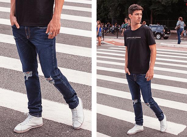 Calça masculina jeans escuro com rasgos nos joelhos