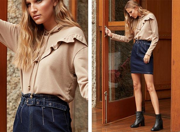 Look de inverno com saia jeans e moletom feminino
