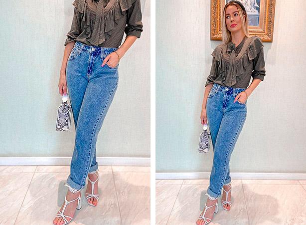 Calça jeans dobrada na barra