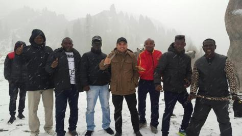 Boxers from Ghana having fun at a snowy Kazakh hillside, 2016.