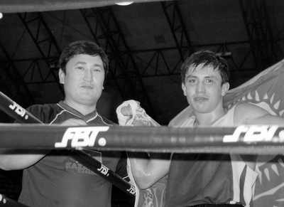 Serik Kaliyev and Gennady Golovkin in the ring.