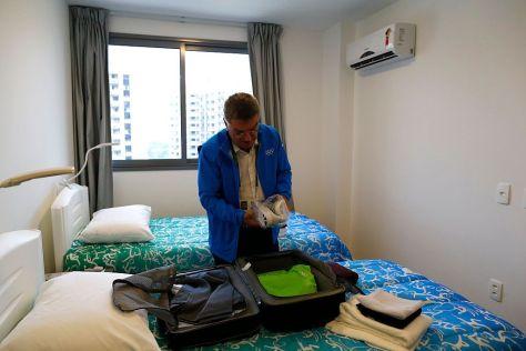 Президент Международного Олимпийского комитета Томас Бах в своём гостиничном номере во время Олимпийских Игр в Рио де Жанейро, 2016.