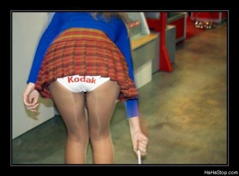 A girl shows off her panties with a Kodak inscription.