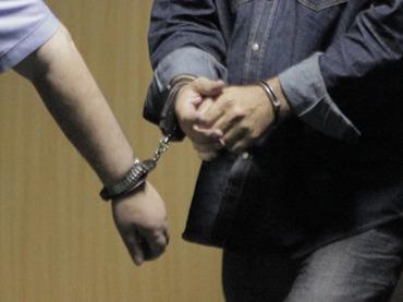 A handcuffed man.