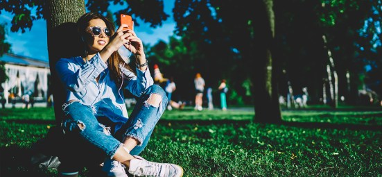 woman-listening-to-music-in-park