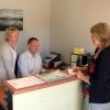 Wendy John Wyn in motel office