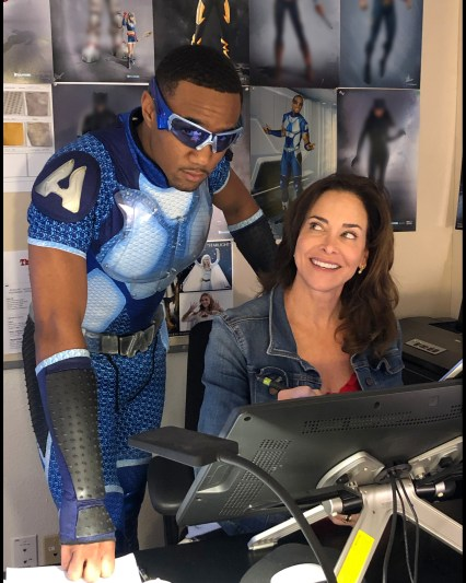 the actor of A-Train wearing the finished costume with Gina