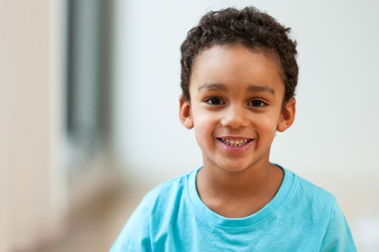 45575989 - portrait of a cute little african american boy smiling