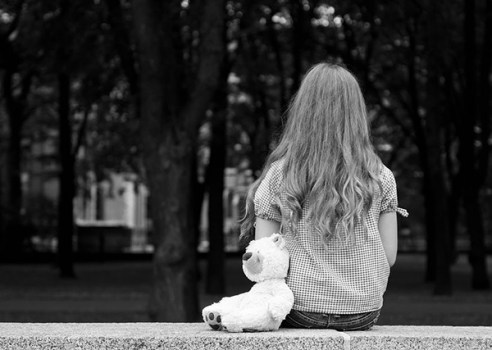 15199512 - young girl sitting in a park black and white photography