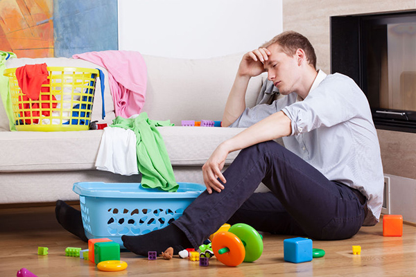 29425433 - lonly tired father sitting with child's toys