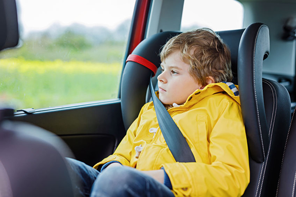 79768527 - tired preschool kid boy sitting in car during traffic jam