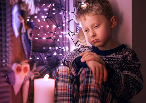 47535158 - sad little boy waiting for christmas presents