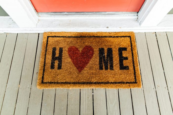 A new home for an old blog symbolised by a welcome home mat.
