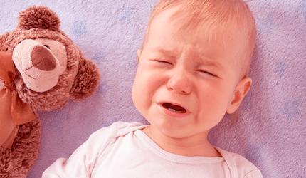 Como aliviar o desconforto do bebê durante a fase de erupção dental?