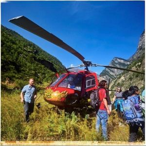 A helicopter flies the team into the remote mountains of Nepal.