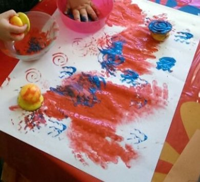 Stamping in blue, red hand print art
