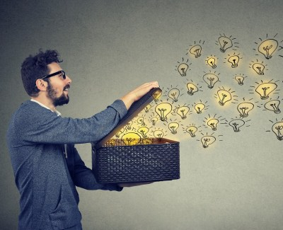 Man opening box and releasing ideas