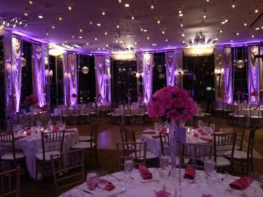 purple uplighting for wedding