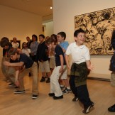 Students move their bodies like the lines in a painting