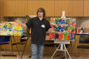 Artist John Bramblitt talks about his artwork during an Art Beyond Sight access program.