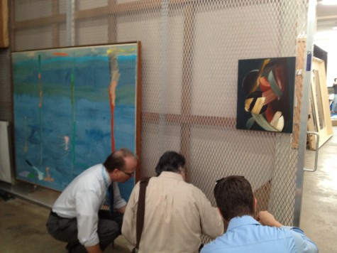 Joel Ferrell, Bob LaVallee, and Mark Leonard looking at the back of our Rothko painting currently in art storage.