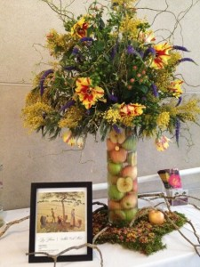 Floral arrangement  inspired by Camille Pissarro's Apple Harvest in the DMA's collection