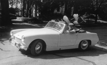 Dallas artist Heri Bert Bartscht moving a sculpture in his convertible, Heri Bert Bartscht Papers