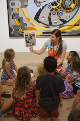 Teacher Leah Hanson telling the story of artist Gerald Murphy in the galleries. (ABCs of Art for ages 4-5)