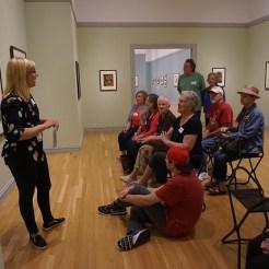 Participants discuss Audubon's bird prints