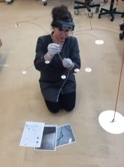 Assistant Conservator Elena Torok examines the mobile's condition.