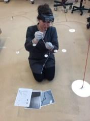 Assistant Conservator Elena Torok examines the mobile's condition.