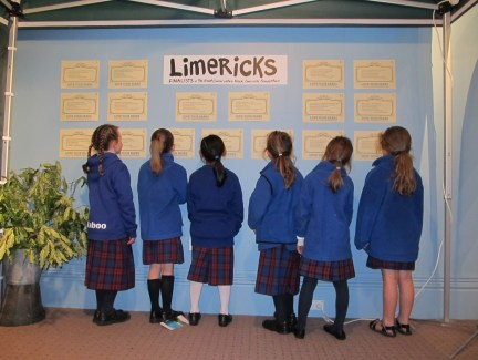 Image of a group of children from St Mary's School, Hokitika, reading the limericks of the finalists.