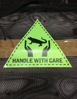 Handle with care tags attached to the tuatara cargo.