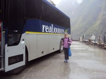 Charlotte standing in front of a bus in Doubtful Sound